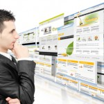Small Business owner choosing from several website options